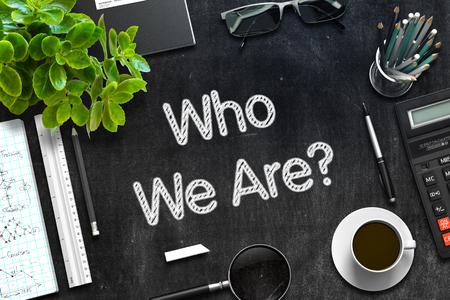 Who We Are Concept on Black Chalkboard. 3D Rendering. Foto de archivo