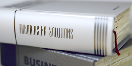 Book Title on the Spine - Fundraising Solutions. Fundraising Solutions Concept. Book Title. Fundraising Solutions - Business Book Title. Toned Image. 3D. Stock Photo