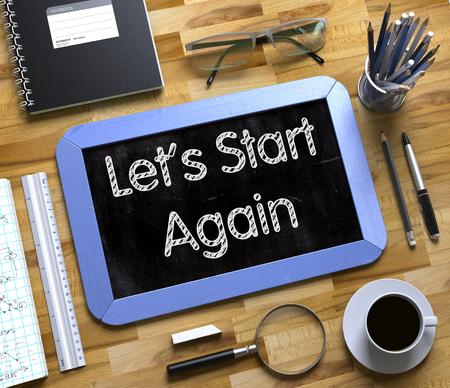 Lets Start Again Handgeschrieben auf kleine Tafel. 3D Lizenzfreie Bilder