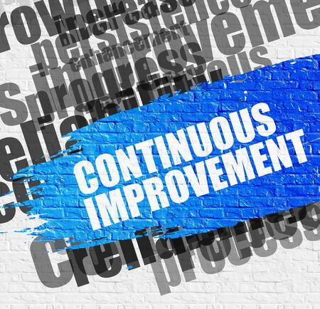 Education Service Concept: Continuous Improvement. Blue Caption on the Brick Wall. Continuous Improvement on Brick Wall Background with Wordcloud Around It. Stock Photo