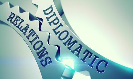 Diplomatic Relations Metal Gears - Enterprises Concept. with Glowing Light Effect. Inscription Diplomatic Relations on Shiny Metal Cog Gears - Communication Concept. 3D .