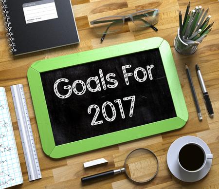 Goals For 2017 Concept on Small Chalkboard. Goals For 2017 Handwritten on Green Chalkboard. Top View Composition with Small Chalkboard on Working Table with Office Supplies Around. 3d Rendering. Lizenzfreie Bilder