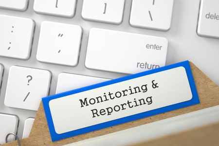 Blue Index Card with Monitoring and Reporting on Background of Modern Laptop Keyboard. Closeup View. Blurred Image. 3D Rendering.