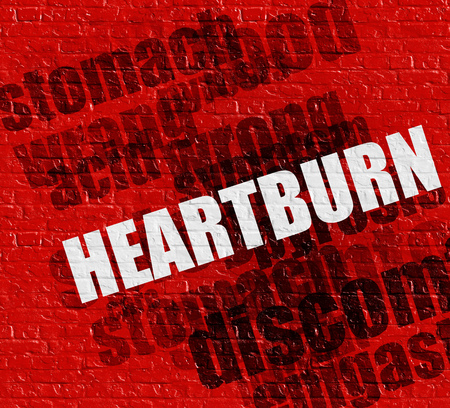 Health concept: Heartburn on the Red Brick Wall . Stock Photo