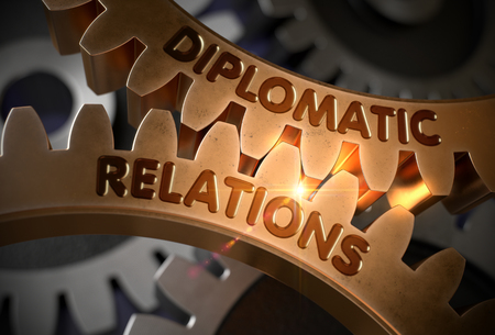 Diplomatic Relations Concept. 3D Golden Gears. Stock Photo