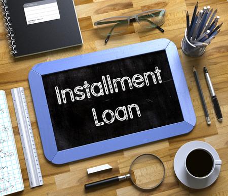 Installment Loan Handwritten on Small Chalkboard. 3D. Standard-Bild