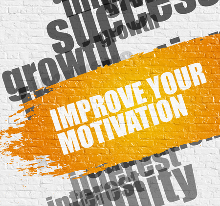 Improve Your Motivation on the White Brick Wall. Standard-Bild