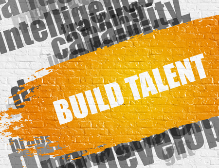 Build Talent on the White Brick Wall.