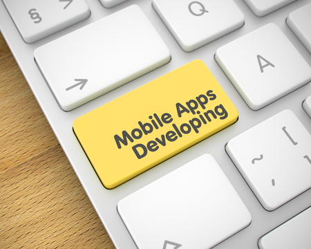 Mobile Apps Developing - Text on Yellow Keyboard Button. 3D.
