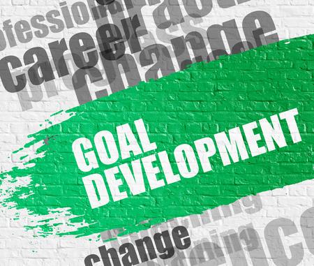 Goal Development on White Brickwall.