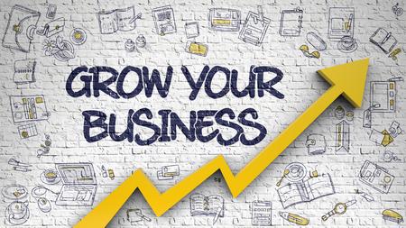 Rozwijaj swój biznes narysowany na białej ścianie. Zdjęcie Seryjne