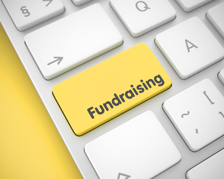 Fundraising - Text on Yellow Keyboard Keypad. 3D.