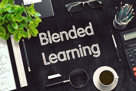 Blended Learning - Text on Black Chalkboard. 3D Rendering.