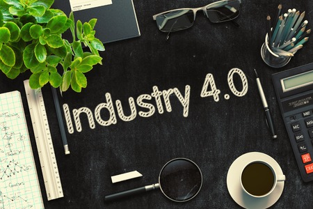 Industry 4.0 Handwritten on Black Chalkboard. 3D Rendering. Stock Photo