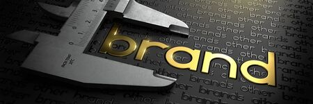 Business Concept with Golden Word BRAND on Black Background and Vernier Caliper. Zdjęcie Seryjne