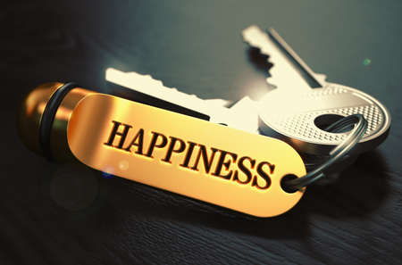 Keys to Happiness - Concept on Golden Keychain over Black Wooden Background. Closeup View, Selective Focus, 3D Render. Toned Image. Stockfoto