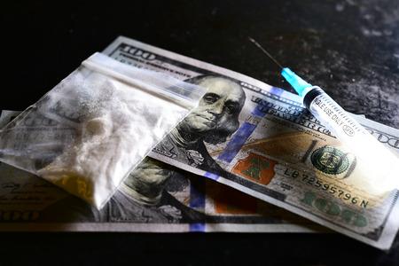 smuggling: The syringe, drugs, money on a dark background