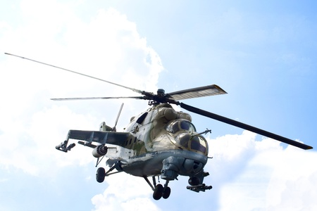 The military helicopter in the sky.