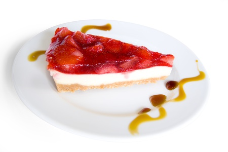 A piece of strawberry cake on white plate