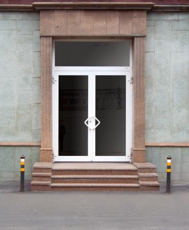 Granite steps. The glass door. Office building.
