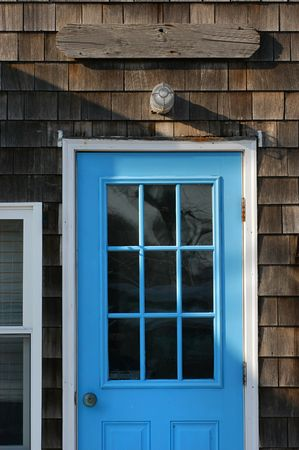 massachussets: Bright blue door with empty place for sign Stock Photo