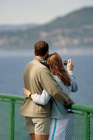 Couple taking pictures on honeymoon