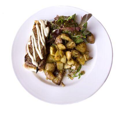 ny: NY steak with roasted potato and salad Stock Photo