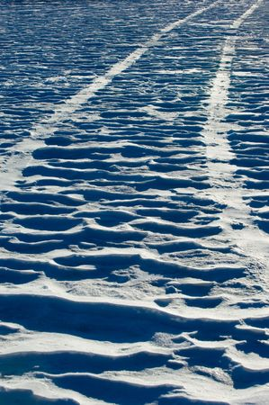 Tire traks on snow field Stock Photo - 396298