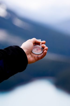 hand: Hand with compass in the mountains