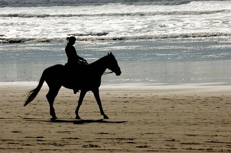 vacationer: Horseback riding, Cannon beach, Oregon coast, USA