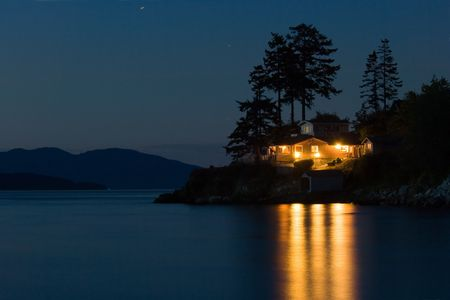 Lighted house on Pacific coast, Washington state Stock Photo