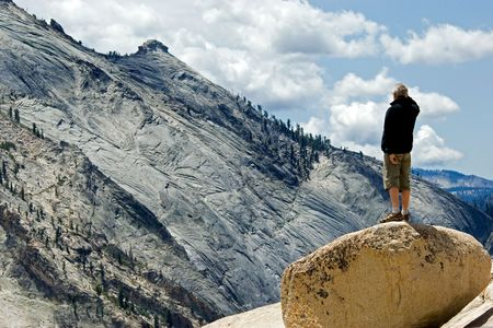 Active middleaged man bserving Yosemite national park photo
