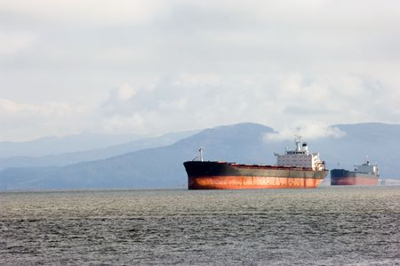 Cargo ship leaving Columbia river delta, Oregon photo