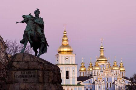 ukraine: Famous Kiev landmarks - Bogdan Khmelnitsky statue and St. Michaels cathedral Stock Photo