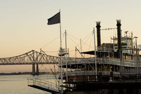 Steamboat on Mississippi river in New Orleans at sunset time photo
