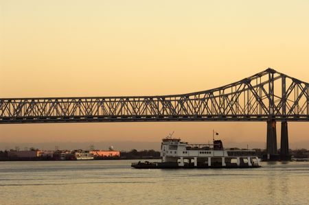 mississippi river: Ferry crossing Mississippi rover at sunset in New Orleans