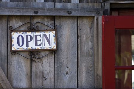 Open sign on spanish tiles, wooden door, St. Augustine, Florida