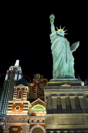 New York New York casino and replica of statue of Liberty on Las Vegas strip at night photo