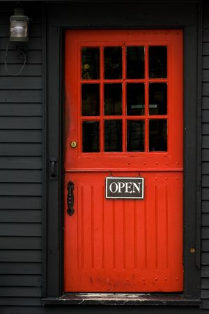 Open sign on red door in Massachusetts vacation town photo