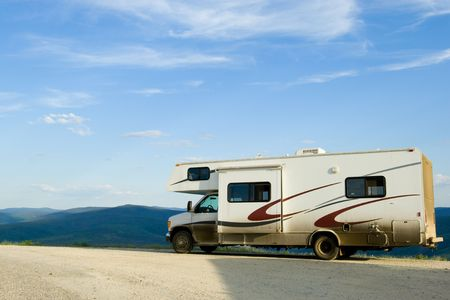 Recreational vehicle on Alaskan dirty road in the mountains photo