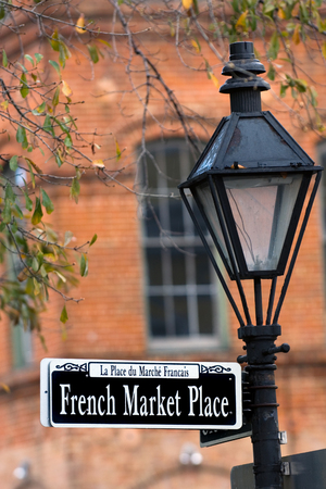 parade: French Market Place sign in New Orleans in French Quarter