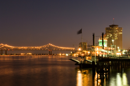 Hotels and bridge over Mississippi river at dusk Stock Photo