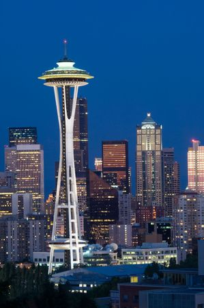 Seattle highrises with Space needle in the evening