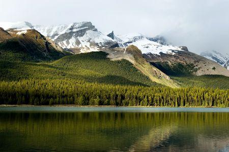 rockies: Rockies mountain range reflecting in Maligne lake, Jasper national park