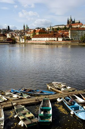 Hradcany castle across Vltava river in fall, Prague photo