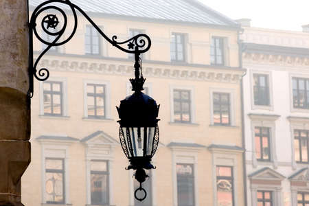 Antique metal street lamp on Market Square, Krakow, Poland