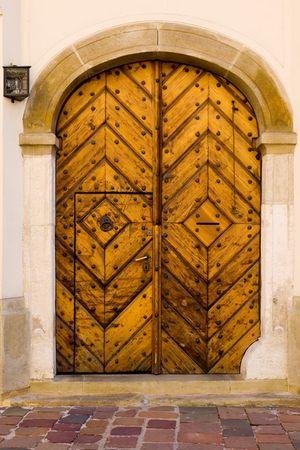 xv century: Wooden door of XV century house in old part of Krakow, Poland