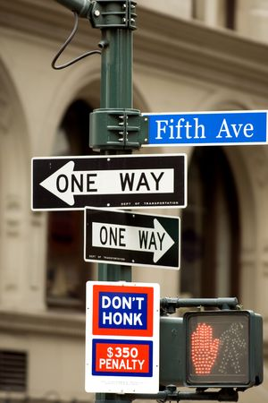 honk: Fifth Avenue sign in pedestrian crossong, midtown Manhattan, NYC