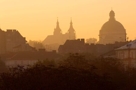 Cathdrals and roofs of Lvov at sunrise, Ukraine Stock Photo