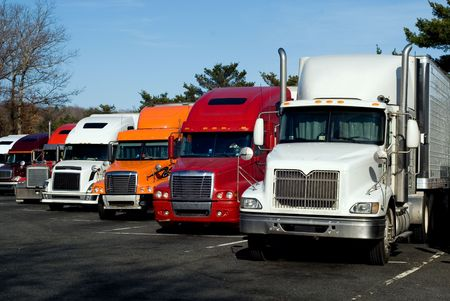 truck on highway: Truck trailers on rest area along american Interstate 95